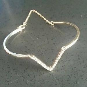 Jewelry - Gold-tone bracelet with Rhinestone V